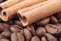 Roasted coffee beans background with cinnamon Royalty Free Stock Photo