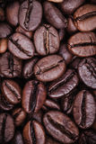 Roasted coffee beans background concept. Close up Grains from coffee the top view, vertical photo Stock Photo