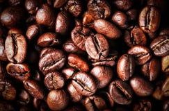 Roasted Coffee Beans background texture. Arabic roasting coffee. Ingredient of hot beverage. Brown coffee beans for background and texture Stock Photos