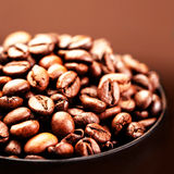 Roasted Coffee Beans background texture macro. Brown coffee bean Stock Image