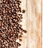 Roasted Coffee Beans background texture on wooden board frame is Royalty Free Stock Image