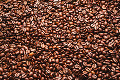 Roasted coffee beans. Background, top view. Roasted coffee beans in golden light Stock Photo