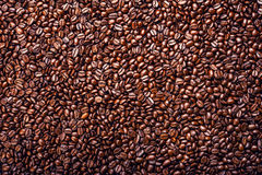 Roasted coffee beans. Background, top view. Roasted coffee beans in golden light Stock Photos