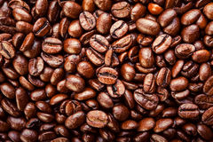 Roasted coffee beans. Background, top view. Roasted coffee beans in golden light Royalty Free Stock Photos