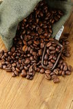 Roasted coffee beans in a bag with scoop Royalty Free Stock Photo