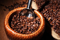 Roasted coffee beans in a bamboo basket Stock Images