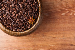 Roasted coffee beans in a bamboo basket Stock Photography