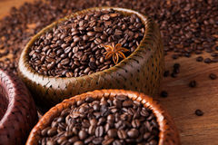 Roasted coffee beans in a bamboo basket Royalty Free Stock Photo