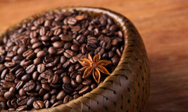 Roasted coffee beans in a bamboo basket Stock Image