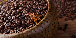 Roasted coffee beans in a bamboo basket Royalty Free Stock Image