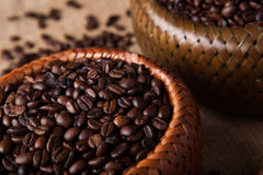 Roasted coffee beans in a bamboo basket Royalty Free Stock Photos