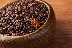 Roasted coffee beans in a bamboo basket Royalty Free Stock Images