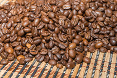 Roasted coffee beans on a bamboo mat. Sorting roasted coffee beans on a bamboo mat Stock Photo