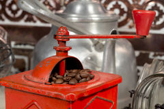 Roasted coffee beans being grinded with a manual coffee grinder Stock Photo