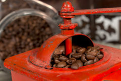 Roasted coffee beans being grinded in traditional style Royalty Free Stock Photography