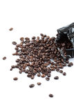 Roasted coffee beans from black bag Royalty Free Stock Photos