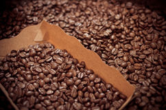 Roasted coffee beans in the blox, focus some part of all.  stock photo