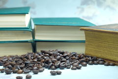Roasted coffee beans and book Royalty Free Stock Photography