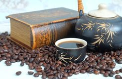 Roasted coffee beans and book Stock Image