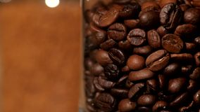 Roasted coffee beans in bottle, close up stock footage
