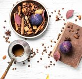 Roasted coffee beans. Coffee beans in bowl with anise, cinnamon and almonds Stock Images