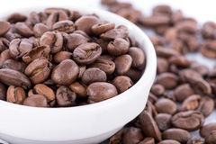 Roasted coffee beans in a bowl Stock Images