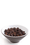 Roasted coffee beans in a brown bowl Stock Images