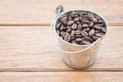 Roasted coffee beans in bucket Royalty Free Stock Photos