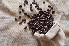 Roasted coffee beans in a burlap bag. Roasted coffee beans arabica in brown burlap bag can use for background Stock Image