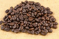 Roasted coffee beans on burlap cloth Royalty Free Stock Photo