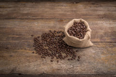 Roasted coffee beans in burlap sack, coffee beans in burlap bag Stock Image