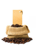 Roasted coffee beans in burlap sacks and Price tag Stock Image
