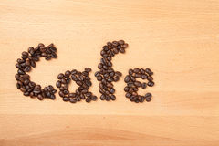 Roasted coffee beans in cafe word shape Stock Photo