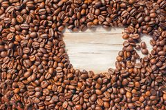 Roasted coffee beans, can be used as a background. Coffee frame of roasted beans in the form of a cup stock image