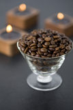 Roasted coffee beans and candles Royalty Free Stock Photos