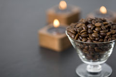Roasted coffee beans and candles Royalty Free Stock Images