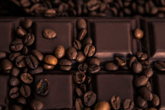 Roasted coffee beans and chocolate bar  close-up Stock Photography