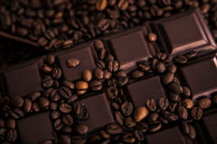 Roasted coffee beans and chocolate bar  close-up Royalty Free Stock Images