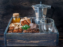 Roasted coffee beans, chocolate, cinnamon, star anise and honey in a wooden box Royalty Free Stock Photo