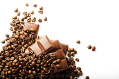Roasted coffee beans and chocolate pieces Stock Images