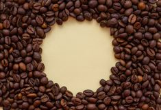 Roasted coffee beans with circle copy space in the middle. Aroma drink concept. stock photos