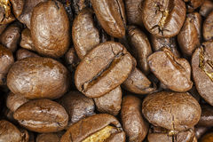Roasted coffee beans, close up. Royalty Free Stock Images