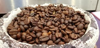 roasted coffee beans close up in stone bowl in business convention centre stock photos