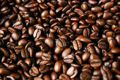 Roasted coffee beans. Closeup of roasted coffee beans after roasting in a drum type coffee roaster Stock Photo