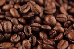 Roasted coffee beans closeup top view as background. Royalty Free Stock Image