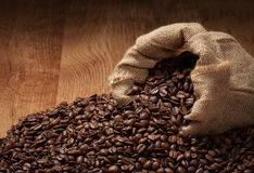 Roasted coffee beans with cloth sack Royalty Free Stock Image