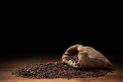 Roasted coffee beans with cloth sack Royalty Free Stock Images