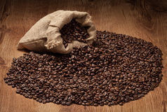 Roasted coffee beans with cloth sack Stock Images