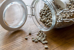 Roasted coffee beans,Coffee beans in glass jar on wooden backgro Royalty Free Stock Photos
