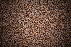 Roasted coffee beans and coffee beans vignette background Stock Photos